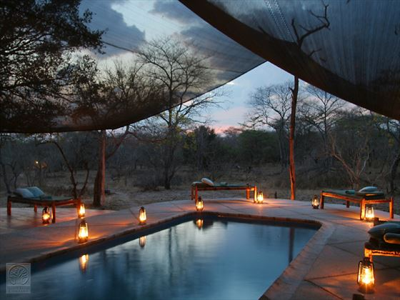 Swimming pool at night at Selous Safari Camp