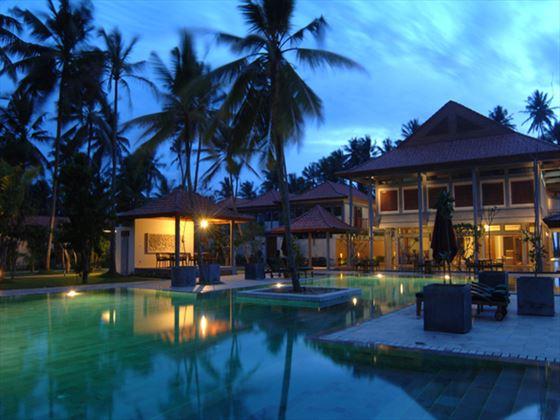 Swimming pool at night at Serene Pavilions