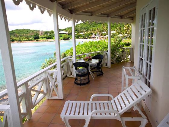 Terrace area at The Great House at Hawksbill by rex resorts