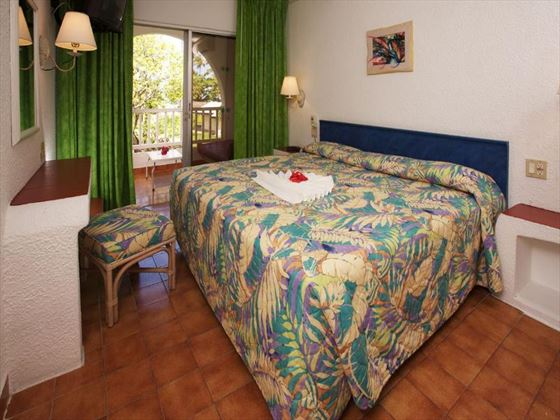 Typical bedroom at Jolly Beach Resort & Spa