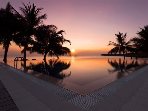 Sunset at the pool at Vilamendhoo Island Resort & Spa