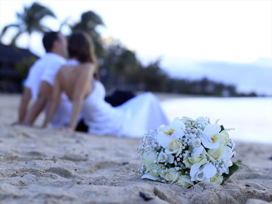 Bride & Groom relaxing on the beach at Veranda Pointe Aux Biches