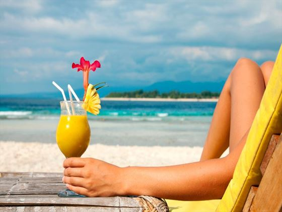 Refresh with an inclusive tropical cocktail on the beach in Barbados