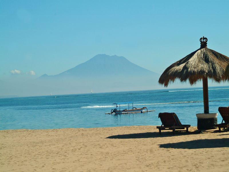 Beach palapas at Bali Tropic