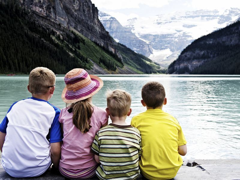 children on the banks of lake louise