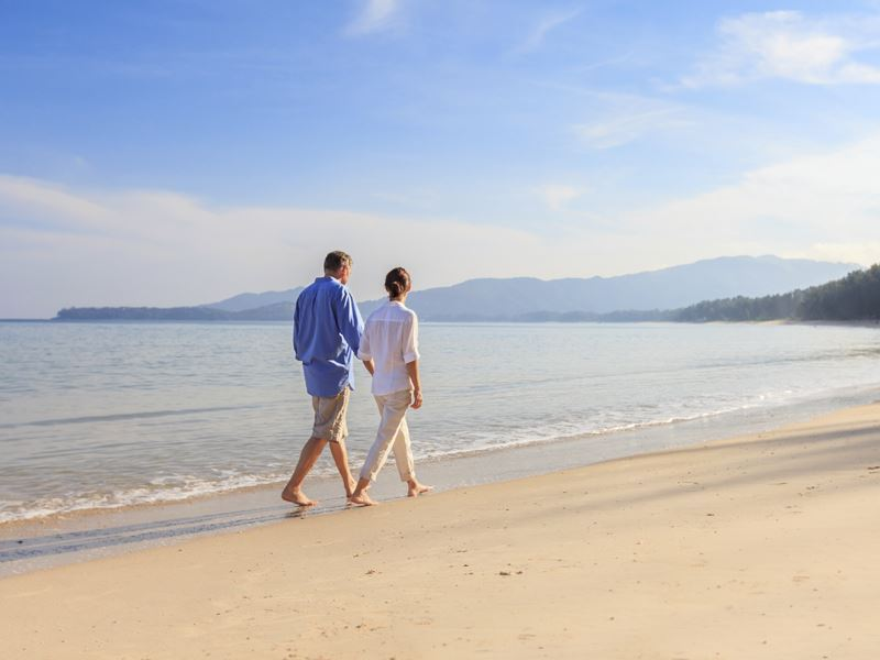 couple walks along beach