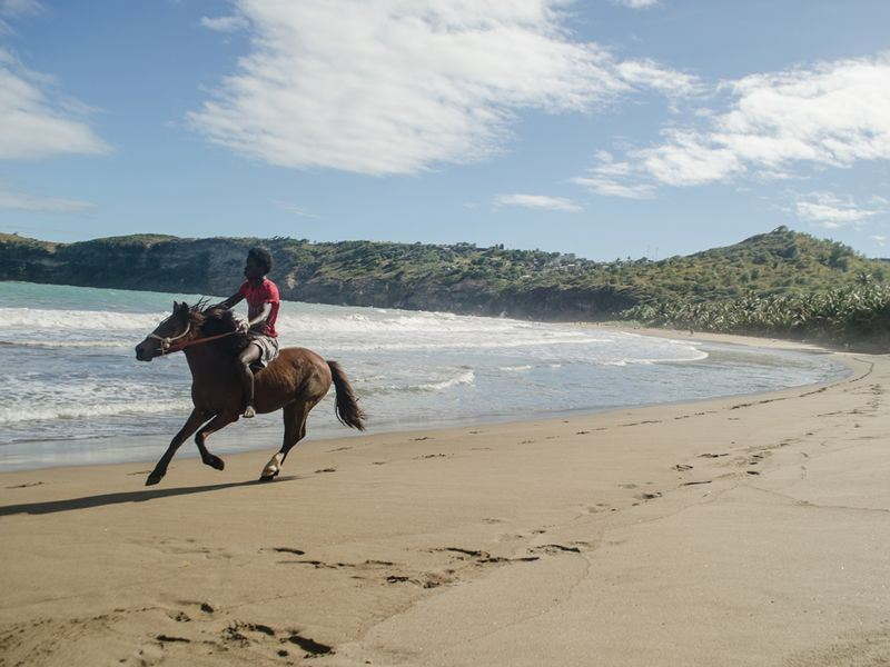horse riding on fond dor beach