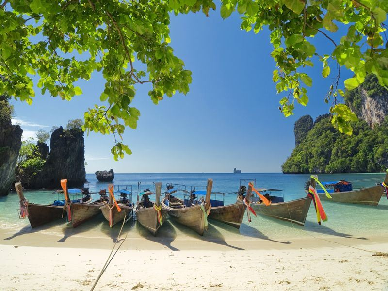 longtail boats at the beach in krabi