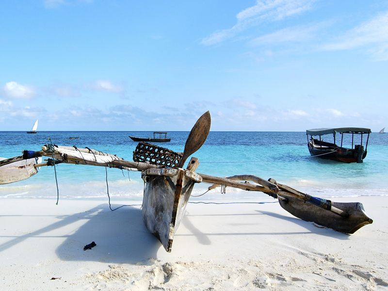 Outrigger canoe on a Zanzibari white sand beach