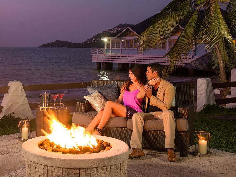 relaxing evening by the firepit at sandals halcyon beach