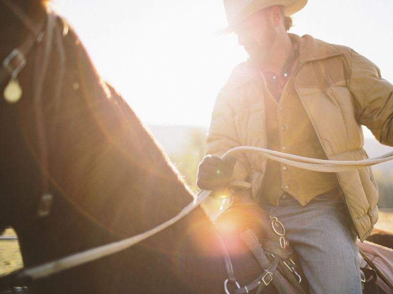 riding horseback on a ranching holiday