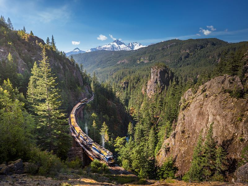 rocky mountaineer travelling through cheakamus canyon on the rainforest to gold rush route