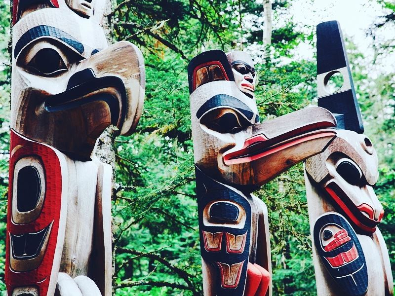 totem poles in kitselas canyon british columbia