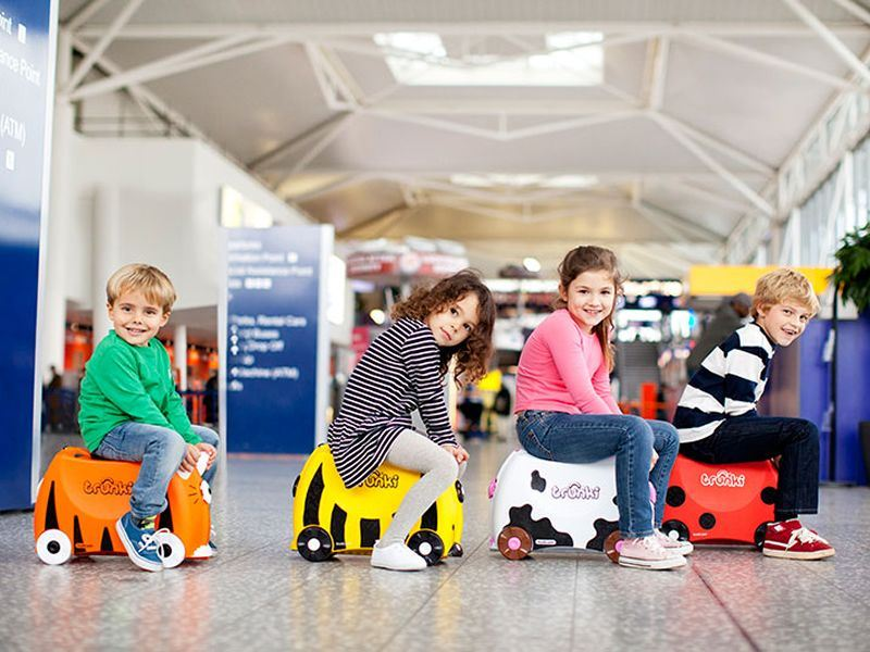 Kids riding their Trunki's at the airport