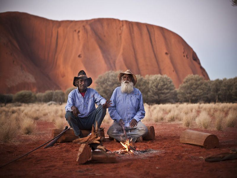 uluru with aboriginal australians   james fisher  tourism australia