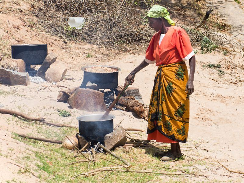 villager preparing food in rural kenya