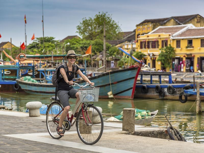 woman cycling in hoi an